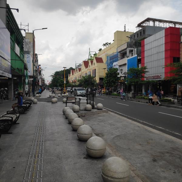 The main shopping street in Yogyakarta under dark grey skies