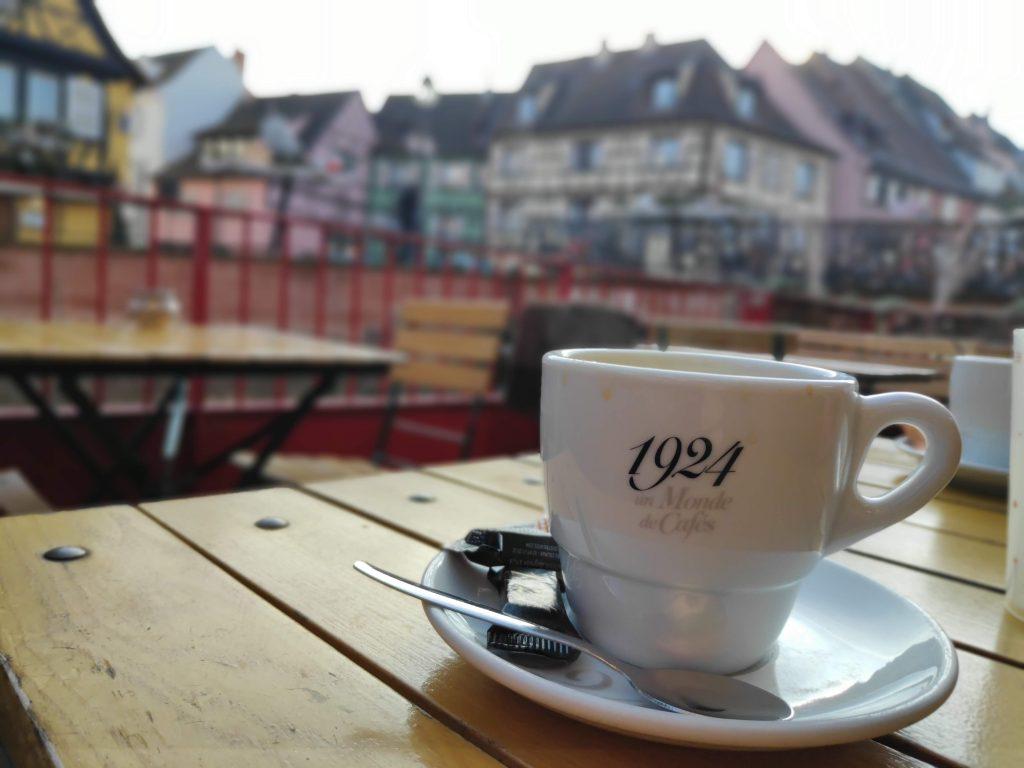 having coffee in the Little Venice area of Colmar
