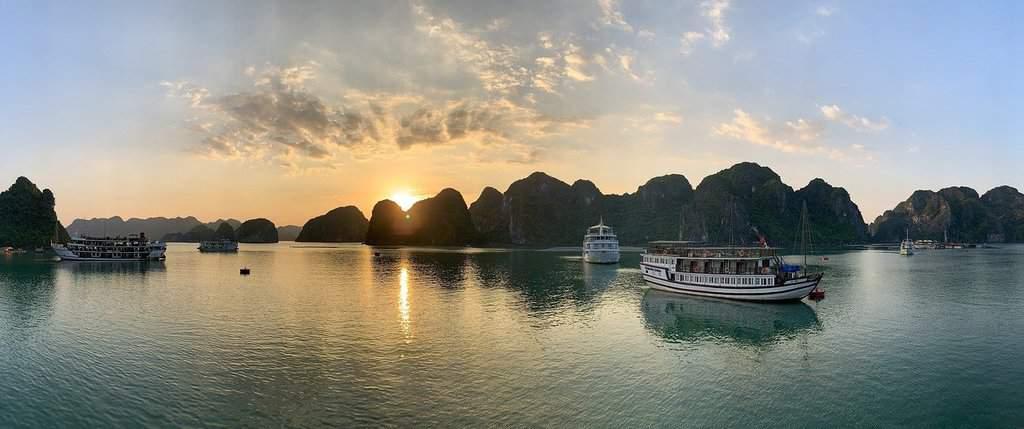Sunset at Halong Bay Vietnam. All boat cruises include kayaking