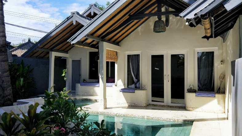 A white villa with private pool at Lilan Lovina Beach ion North Bali
